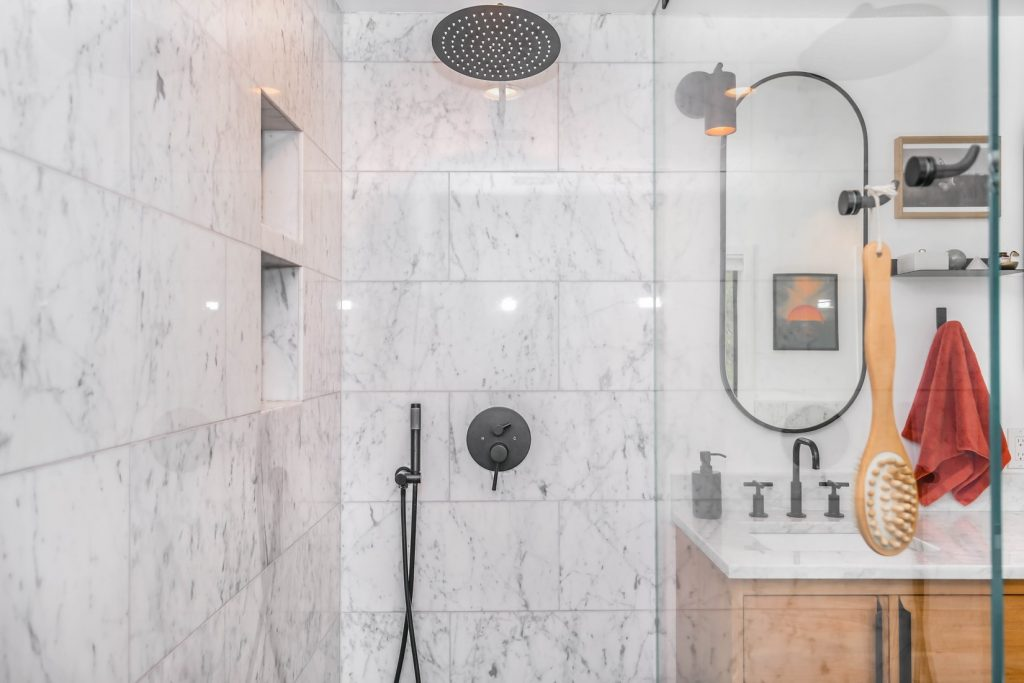 where should the drain be placed in a shower