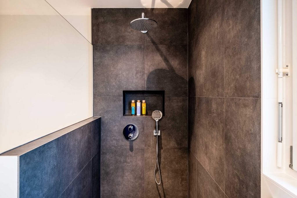 can shower head be on exterior wall