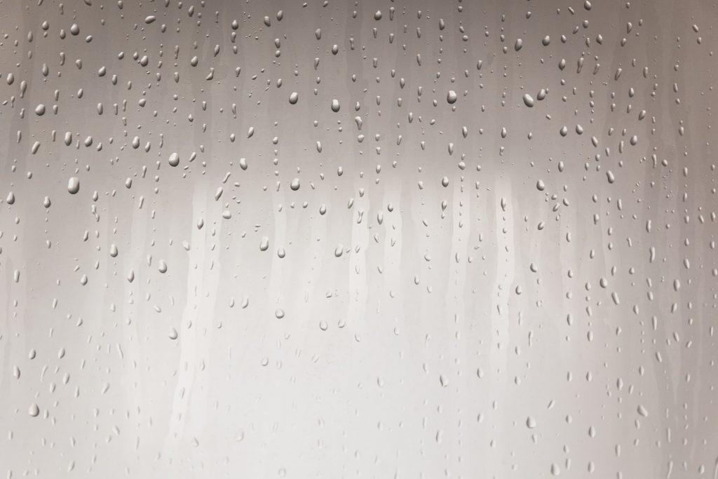 can shower doors swing in