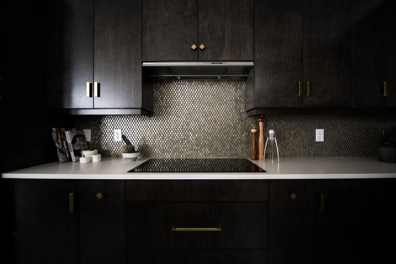 where to stop backsplash behind stove