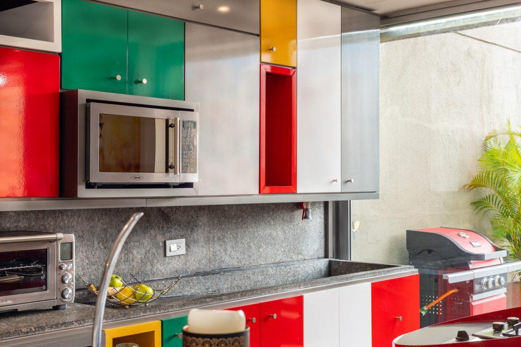 why are microwave doors so loud