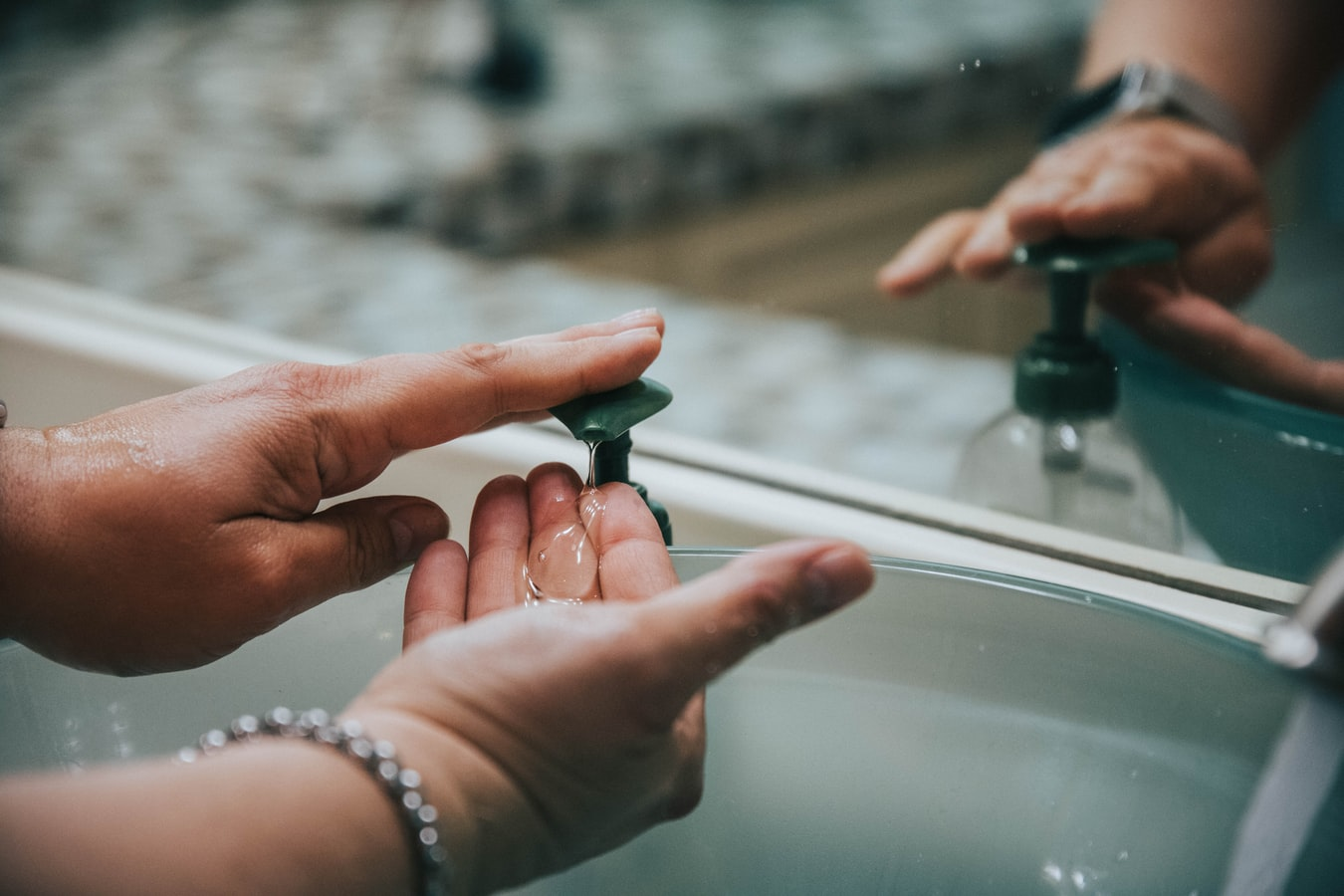 how to take apart a soap dispenser pump