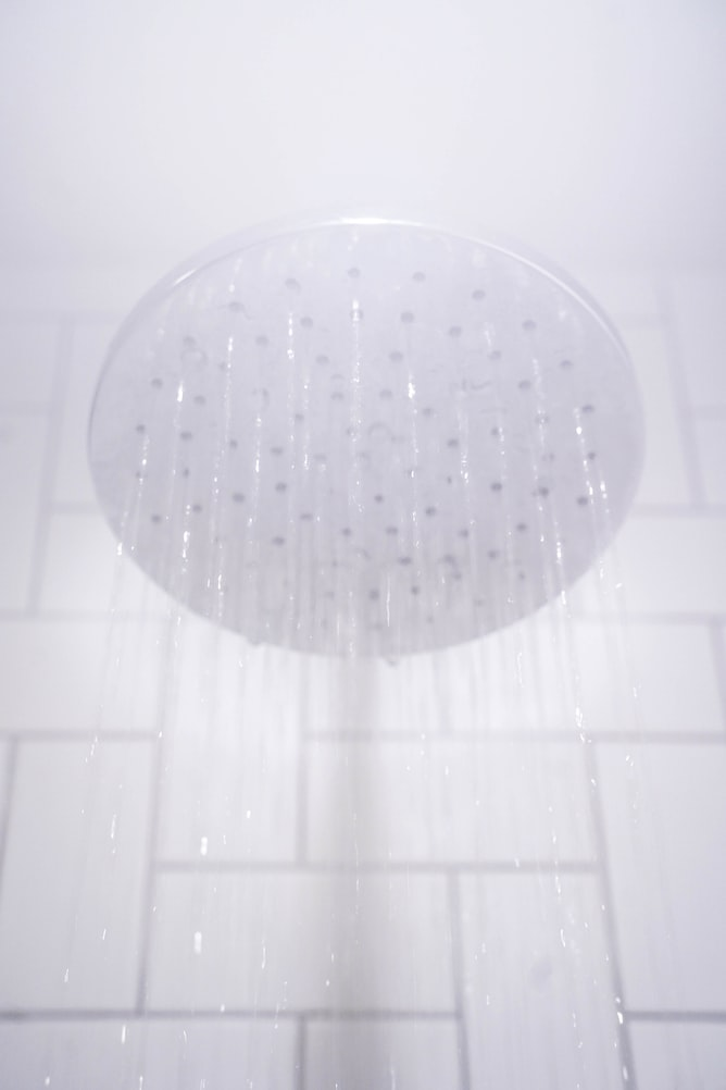 Apply Mixture On The Shower Head